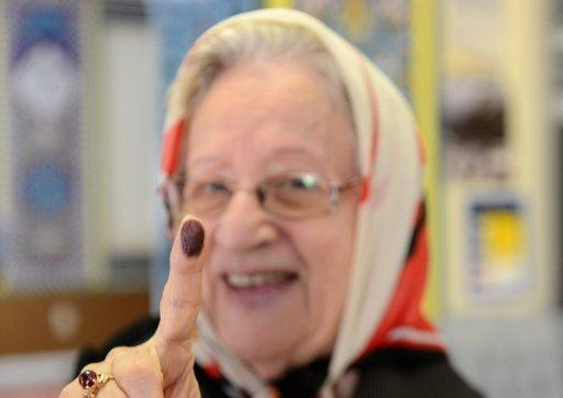 An Iranian citizen shows her finger covered in ink after voting in the Iranian presidential election at a polling station set up inside the Manassas Masjid mosque in Manassas, Virginia, in the United States on June 14, 2013. Moderate cleric Hassan Rowhani, bolstered by a late surge in support from suppressed Iranian reformists, was leading the race on Saturday