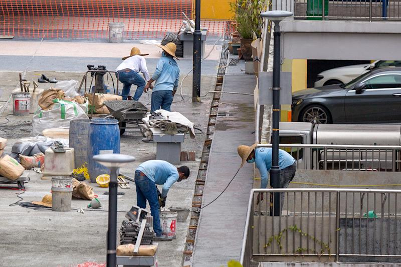 Migrant workers seen at work in the Queen's Road area. (PHOTO: Dhany Osman / Yahoo News Singapore)