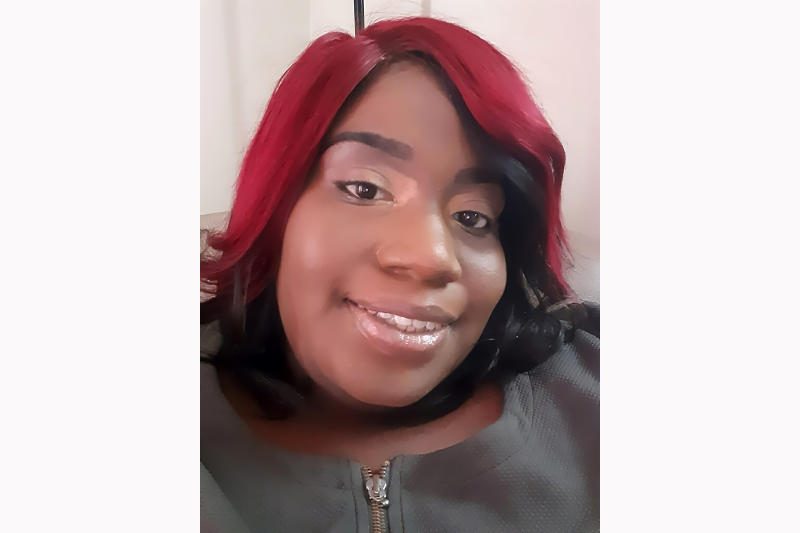 In this March 30, 2020 photo, Tinisha Dixon, 26, takes a selfie at her apartment in Atlanta. She is scrambling to come up with the $1115 in monthly rent for the apartment she shares near downtown Atlanta with her partner and their five kids. She said she was set to get a job at the State Road and Tollway Authority, but that was put on hold. She worries the family will be evicted and become homeless again. (Tinisha Dixon via AP)