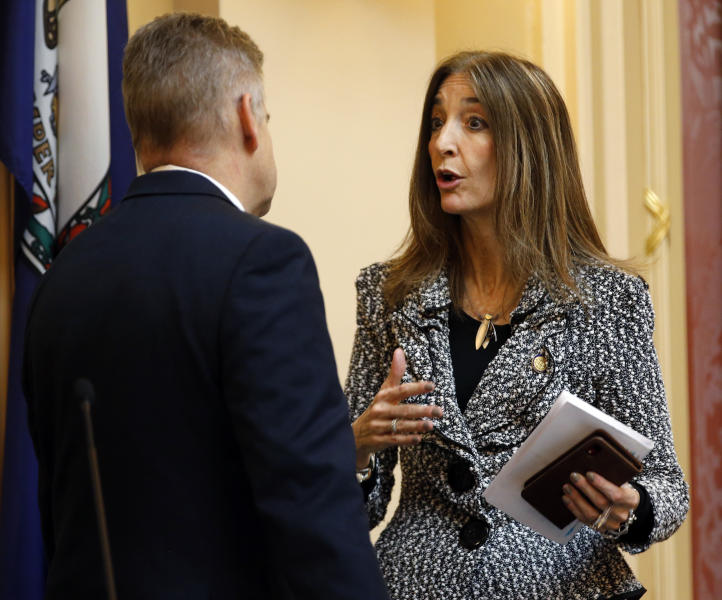 FILE - This Thursday Jan. 17, 2019 file photo shows Del. Eileen Filler-Corn, D-Fairfax, right, as she speaks with House speaker Kirk Cox, R-Colonial Heights, during the House session at the Capitol in Richmond, Va. Filler-Corn was selected by the new House Democratic majority as the new speaker of the House. (AP Photo/Steve Helber)