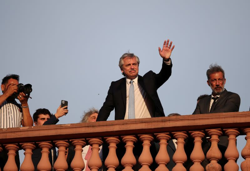 FILE PHOTO: Argentina's President Alberto Fernandez waves from the balcony of the Casa Rosada Presidential Palace after his inauguration, in Buenos Aires
