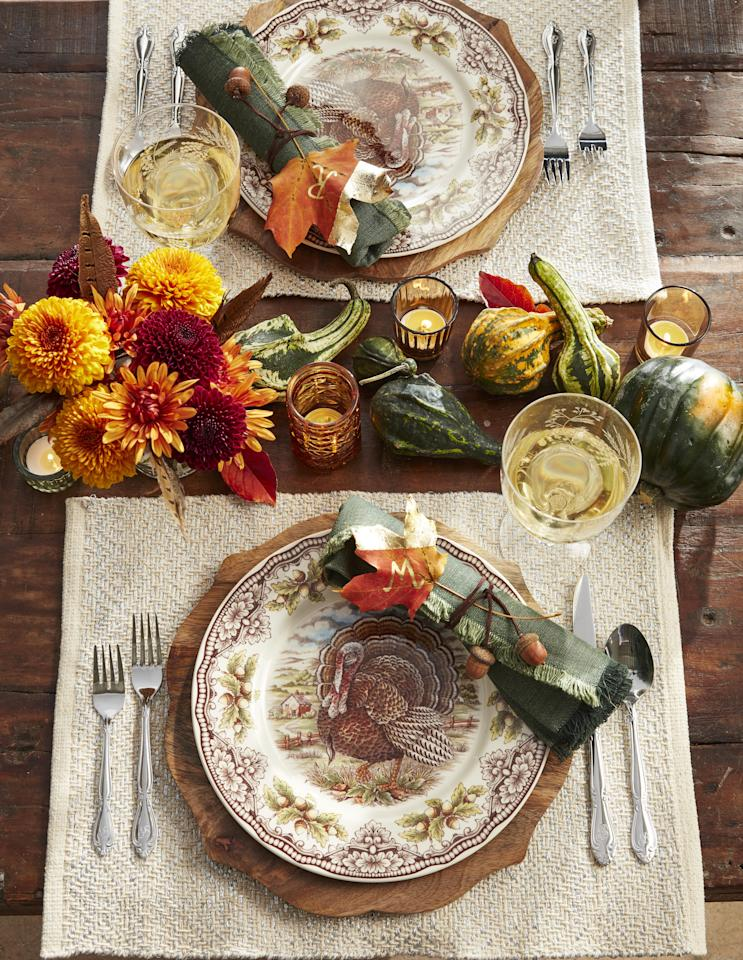 """<p>While you may love to experiment in the kitchen, when it comes to your <a href=""""https://www.countryliving.com/food-drinks/g637/thanksgiving-menus/"""" target=""""_blank"""">Thanksgiving menu</a> most families stick with tradition and prepare the same dishes year after year. Tradition has its place, but don't let your imagination be stifled. This year use that creativity and crafting know-how to make  an inviting, unique fall scene with one of these easy DIY projects. From rustic <a href=""""https://www.countryliving.com/entertaining/g634/thanksgiving-table-settings-1108/"""">Thanksgiving table settings</a> to easy Thanksgiving decorating ideas for your living and dining room, there's a new idea in here for just about every host—regardless of personal style or taste. Twirl up <a href=""""https://www.countryliving.com/entertaining/g2130/thanksgiving-centerpieces/"""">Thanksgiving centerpieces</a> to delight all your dinner guests, make charming ice buckets out of fake, reusable pumpkins, or string together miniature wreaths with which to decorate your candles. When it comes to DIY decor, the possibilities are endless! </p><p>Looking for outdoor Thanksgiving decorations, too? We've got a ton of those: Our Thanksgiving <a href=""""https://www.countryliving.com/diy-crafts/g2610/fall-door-decorations/"""">door decorations</a>  and <a href=""""https://www.countryliving.com/diy-crafts/g1988/fall-craft-projects/"""">fall wreaths</a> are an easy way to refresh your front porch and make a lasting impression on your guests before they even set foot inside. Of course, on Thanksgiving, the dining room table should be considered the crown jewel of your home. That's why we've put so much thought into Thanksgiving decoration ideas that'll delight your entire family—even your youngest kids. Whether you're looking for a fun kraft paper tablecloth, a printable banner, or an inexpensive arrangement, we've got you covered.</p>"""