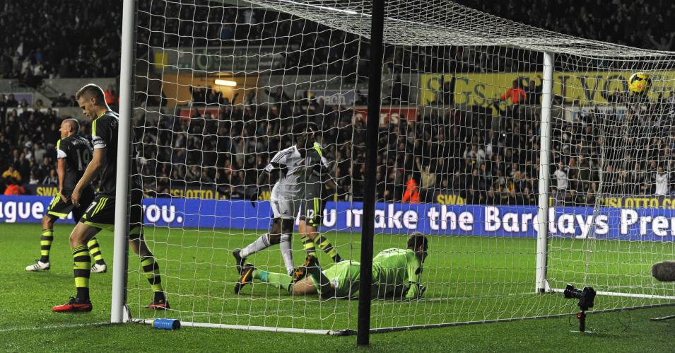 Stoke City's Begovic is beaten by a shot from Swansea City during English Premier League in Wales