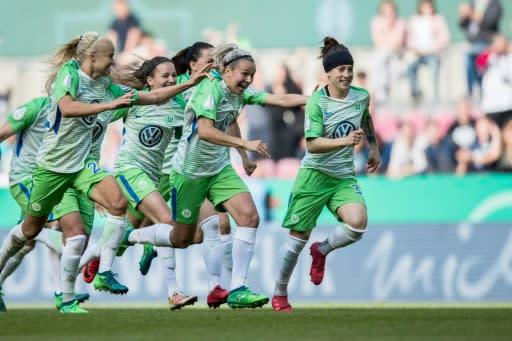 Wolfsburg players celebrate beating Bayern Munich in the German Cup final