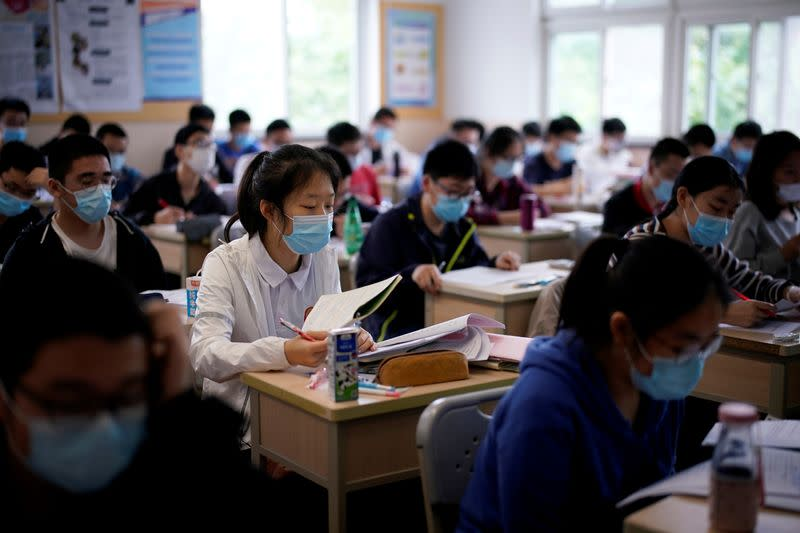 FILE PHOTO: Students are seen inside a classroom at a high school in Shanghai