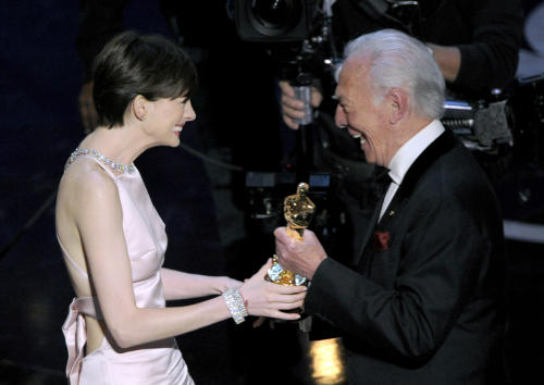 """Actor Christopher Plummer, right, presents the award for best actress in a supporting role to Anne Hathaway for """"Les Miserables"""" during the Oscars at the Dolby Theatre on Sunday Feb. 24, 2013, in Los Angeles. (Photo by Chris Pizzello/Invision/AP)"""