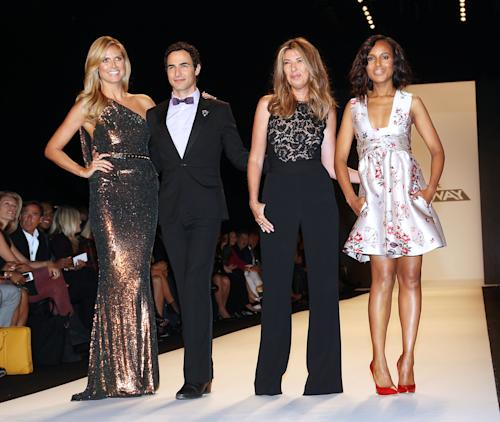 "FILE - This Sept. 6, 2013 file image released by Starpix shows, from left, host Heidi Klum, designer Zac Posen, Nina Garcia and actress Kerry Washington wearing a Stella McCartney floral frock and red leather pumps as a judge, at the ""Project Runway"" show during Fashion Week in New York. An ""it"" girl of the Hollywood-fashion nexus becomes even hotter. TV's ""Scandal"" actress Kerry Washington made glamorous appearances at New York Fashion Week, where she judged ""Project Runway"" in a pretty Stella McCartney floral number, and at the Emmys, in an eye-catching Marchesa gown. (AP Photo/Starpix, Kristina Bumphrey)"