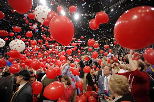 In this Sept. 4, 2008, photo, balloons fall on the floor as Republican presidential nominee John McCain is joined by his wife, Cindy, his family and his running mate, Sarah Palin, and her family, not pictured, on stage after his acceptance speech at the Republican National Convention in St. Paul, Minn. Viewer interest in the 2012 Republican and Democratic national conventions is still unclear. With the parties' quadrennial presidential nominating gatherings fast approaching, organizers on both sides are bedeviled by a similar challenge: how to ensure TV viewer interest in the multiday affairs, which threaten to be largely predictable spectacles nearly devoid of suspense. (AP Photo/Jae C. Hong)