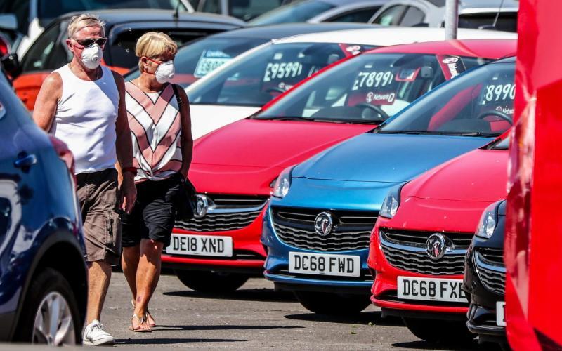 Potential car buyers at Vauxhall Lookers in Speke, Liverpool this week