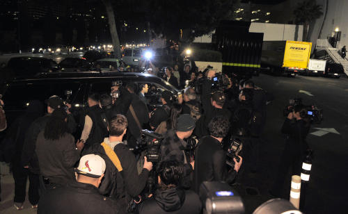A crowd gathers outside the loading dock at the Beverly Hilton Hotel Saturday Feb. 11, 2012 in Beverly Hills Calif. Whitney Houston, who ruled as pop music's queen until her majestic voice and regal image were ravaged by drug use, erratic behavior and a tumultuous marriage to singer Bobby Brown, died Saturday. She was 48.(AP Photo/Mark J. Terrill)