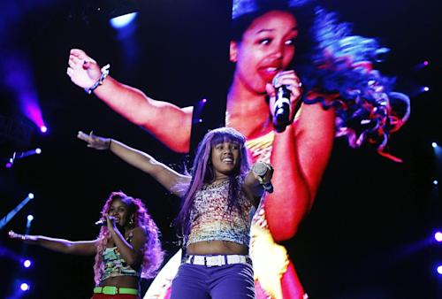 The OMG Girlz perform at the Essence Music Festival in New Orleans, Thursday, July 5, 2012. This is the first day of the four day music festival. (Photo by Bill Haber/Invision/AP)