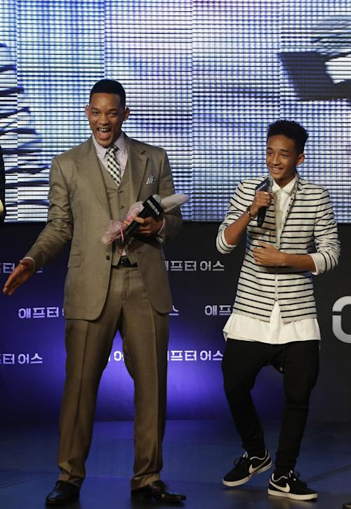 "FILE - In this Tuesday, May 7, 2013 photo, U.S. actor Will Smith and his son Jaden smile during the premiere event of his new film ""After Earth"" in Seoul, South Korea. All three of Smith's children now at least dabble in music and acting, most notably 14-year-old Jaden, who stars with his father in the new sci-fi film. Even in the midst of a globe-hopping promotional tour for the movie, Smith recognizes the downside to making stardom a family affair. (AP Photo/Lee Jin-man, File)"
