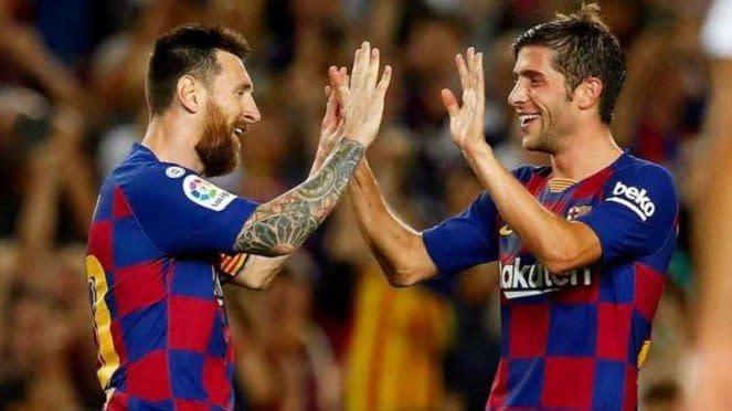 Lionel Messi dan Sergi Roberto