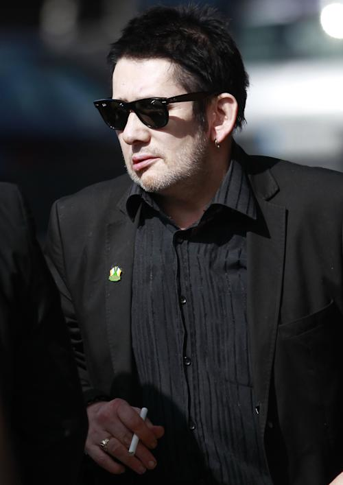Irish singer Shane MacGowan attends the funeral mass of Irish poet Seamus Heaney at the Church of the Sacred Heart in Donnybrook, Dublin, Ireland, Monday, Sept. 2, 2013. Ireland mourned the loss of its Nobel laureate poet, Seamus Heaney, with equal measures of poetry and pain Monday in a funeral full of grace notes and a final message from the great man himself: Don't be afraid. Among those packing the pews of Dublin's Catholic Church of the Sacred Heart were government leaders from both parts of Ireland, poets and novelists, Bono and The Edge from rock band U2, and former Lebanese hostage Brian Keenan. Heaney won the Nobel Prize for literature in 1995 in recognition of his wide-ranging writings inspired by the rural wonders of Ireland, the strife of his native Northern Ireland, the ancient cultures of Europe, of Catholic faith and Celtic mysticism, and the immutability of family ties. He died Friday in a Dublin hospital at the age of 74. (AP Photo/Peter Morrison)