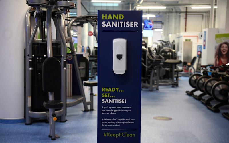 A hand sanitiser station inside the Gym Group in Vauxhall, London, after it was announced that gyms will be allowed to reopen from 25 July - Kirsty O'Connor/PA