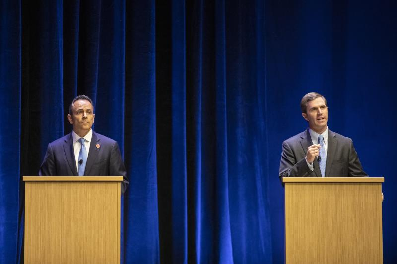 FILE - In this Tuesday, Oct. 15, 2019 file photo, Republican Gov. Matt Bevin, left, and Democratic Attorney General Andy Beshear participate in a debate, in Lexington, Ky. Kentucky's political grudge match between Republican Gov. Matt Bevin and Democratic Attorney General Andy Beshear now lies in the hands of the voters. (Ryan C. Hermens/Lexington Herald-Leader via AP, Pool)