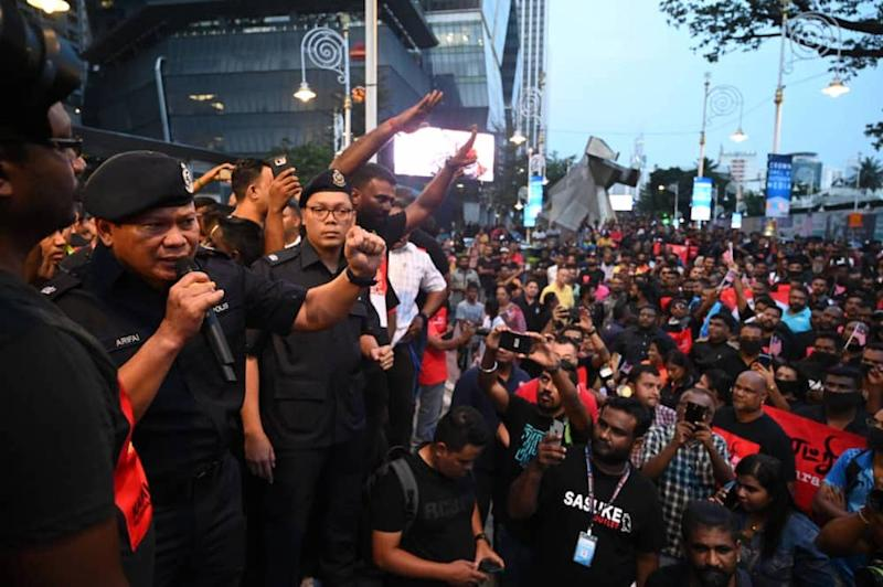 Police monitor a rally in Brickfields, Kuala Lumpur August 23, 2019.