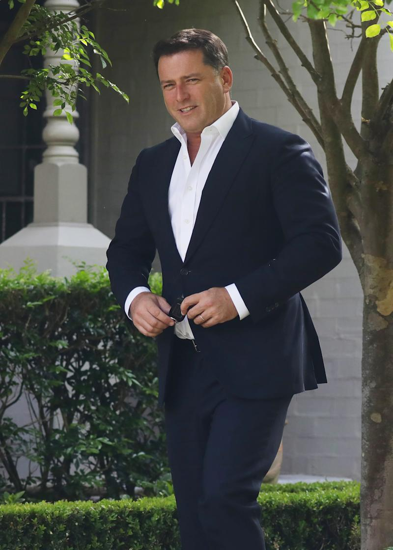 A photo of Karl Stefanovic wearing a navy suit and white shirt at the Channel Nine offices in Willoughby, Sydney.