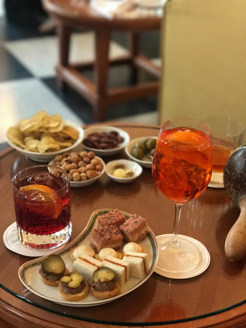 Delicious aperitif and bar snacks before dinner at Belmond Hotel Splendido.