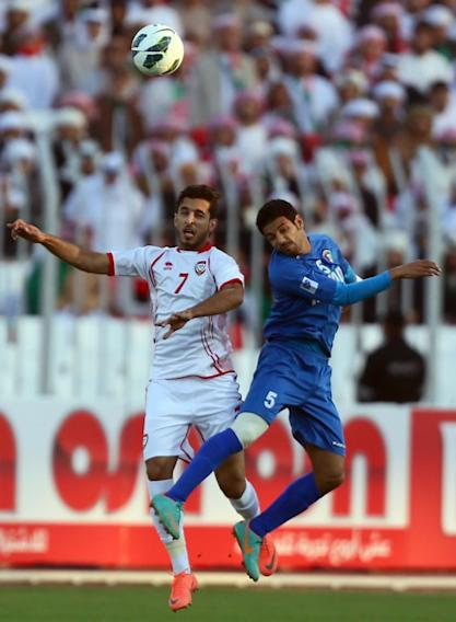 Ali al-Ahajiri (L) of United Arab Emirates vies for the ball against Mohammad Sanad of Kuwait during the two teams' semi-final match in the 21st Gulf Cup in Manama, on January 15, 2013. AFP PHOTO/MARWAN NAAMANI