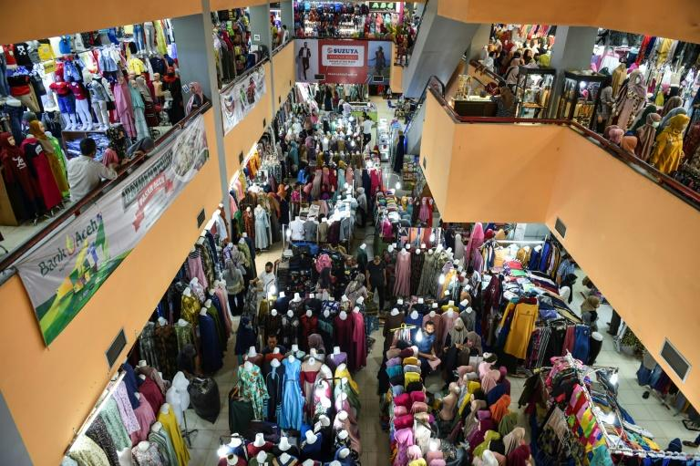Malls and markets in Indonesia have been packed with throngs of shoppers buying food and clothes for Eid celebrations