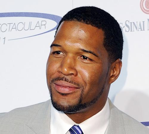 "FILE - This May 22, 2011 file photo shows former NFL football player Michael Strahan at The 26th Annual Sports Spectacular The Hyatt Regency Hotel Century City in Los Angeles, Calif. Former football star Michael Strahan is getting a permanent job in morning television as Kelly Ripa's co-host. Strahan replaces Regis Philbin on the syndicated ""Live! With Kelly"" show, adding his name to the title. The gap-toothed former New York Giant is currently a host of ""Fox NFL Sunday."" He was one of several men to get tryouts with Ripa as the show rotated several potential replacements since Philbin left last November. (AP Photo/Katy Winn, file)"