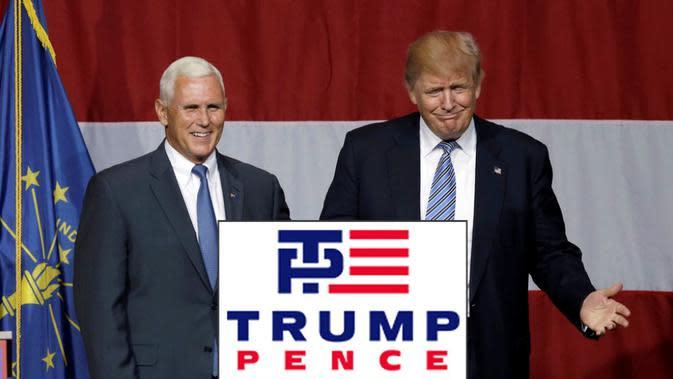 Lambang tersebut memperlihatkan dua huruf biru saling bertautan, T dan P, disertai garis-garis merah, mengilustrasikan bendera AS (Michael Conroy/Associated Press).