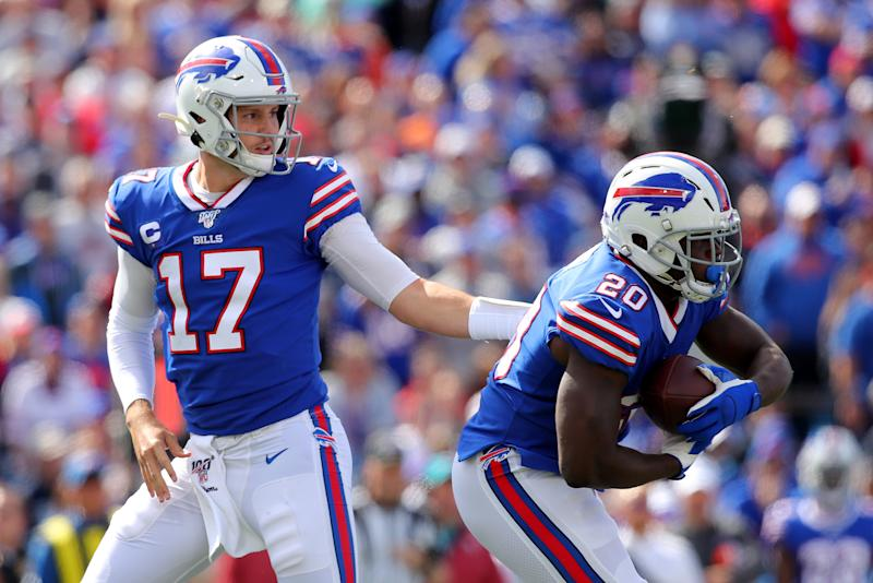 BUFFALO, NEW YORK - SEPTEMBER 29: Josh Allen #17 of the Buffalo Bills hands the ball off to Frank Gore #20 during the first quarter in the game at New Era Field on September 29, 2019 in Buffalo, New York. (Photo by Brett Carlsen/Getty Images)