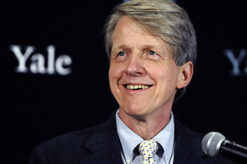 FILE - In this Oct. 14, 2013 file photo, Nobel prize-winning Yale University economist Robert Shiller smiles at a news conference in New Haven, Conn. In his new book with George Akerlof, another Nobel-prize winning economist, Shiller examines the many ways credit-card companies, financial firms and other businesses lure people into buying things that might harm them. (AP Photo/Jessica Hill, File)