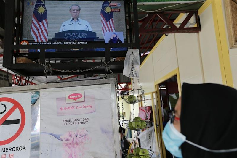 A live broadcast of Prime Minister Tan Sri Muhyiddin Yassin on the recovery movement control order is seen on a television in Kuala Lumpur June 7, 2020. ― Picture by Ahmad Zamzahuri
