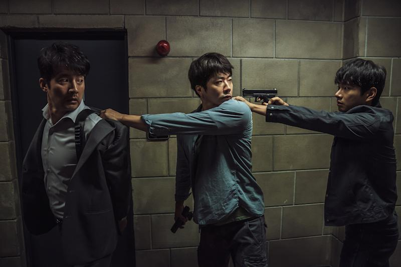 Kwon Sang-woo (centre) stars in Hitman: Agent Jun. (PHOTO: Golden Village Pictures)
