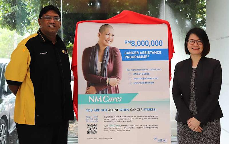 Nilai Medical CEO Jasmine Lau (right) with National Cancer Society Malaysia general manager and medical director Dr Murallitharan Munisamy. — Picture courtesy of Nilai Medical