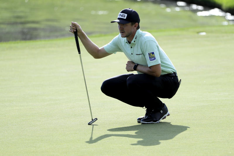 Mackenzie Hughes, of Canada, lines up his putt on the 17th green during the second round of the Travelers Championship golf tournament at TPC River Highlands, Friday, June 26, 2020, in Cromwell, Conn. (AP Photo/Frank Franklin II)