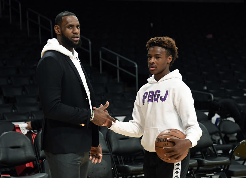 LOS ANGELES, CA - DECEMBER 28: LeBron James #23 of the Los Angeles Lakers and his son LeBron James Jr., on the court after the Los Angeles Clippers and Los Angeles Lakers basketball game at Staples Center on December 28, 2018 in Los Angeles, California. NOTE TO USER: User expressly acknowledges and agrees that, by downloading and or using this photograph, User is consenting to the terms and conditions of the Getty Images License Agreement. (Photo by Kevork Djansezian/Getty Images)
