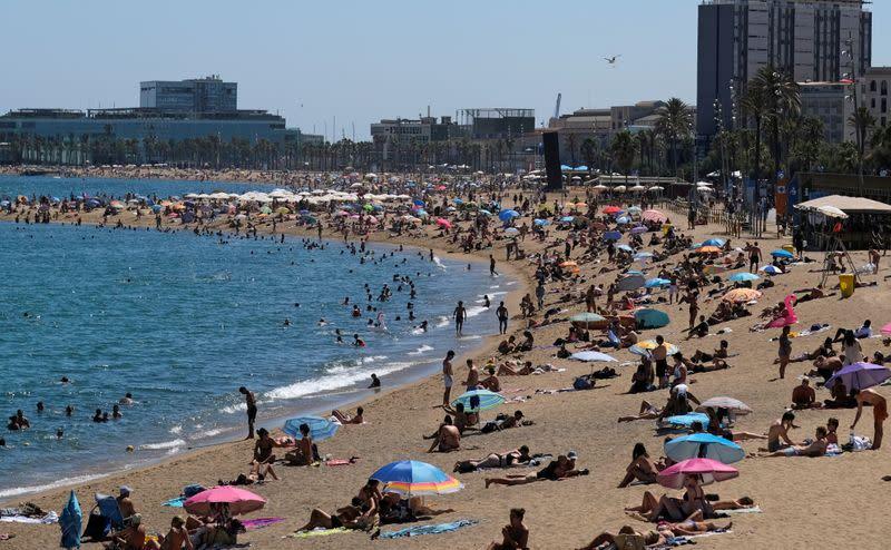 Sun-seekers crowd Barcelona beaches, defying coronavirus stay-at-home advice