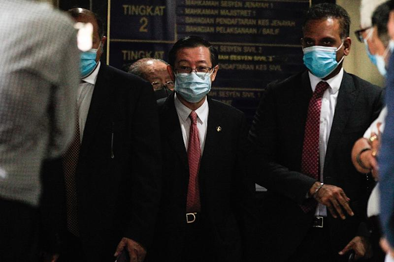 Lim Guan Eng (centre) exits the Butterworth Court Complex August 10, 2020. — Picture by Sayuti Zainudin