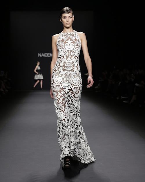 The Naeem Khan Fall 2013 collection is modeled during Fashion Week in New York, Tuesday, Feb. 12, 2013. (AP Photo/Kathy Willens)