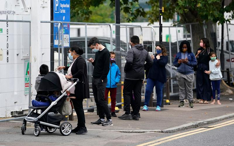 The queue for a testing centre in Edmonton, north London, on Monday - EPA