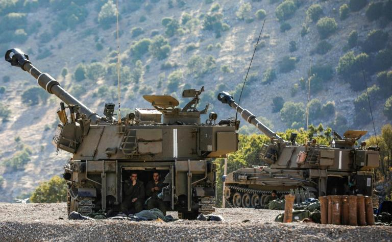 Israeli soldiers sit in the back of a self-propelled artillery gun on the border with Syria in the Israeli-annexed Golan, after US President Donald Trump declared Israeli sovereignty over the area seized by Israel in 1967