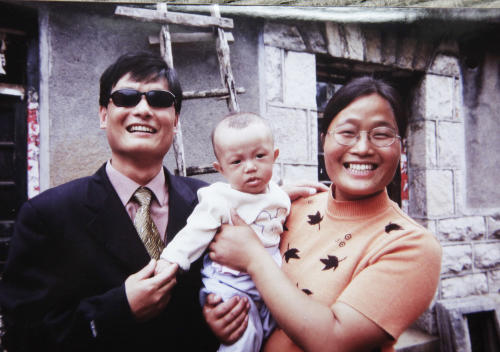 In this 2005 photo provided by Joan Lebold Cohen, Chinese legal activist Chen Guangcheng, left, and his wife, Yuan Weijing, hold their son in Shandong province, China. The U.S. and China forged the outlines of a deal Friday, May 4, 2012, to end a diplomatic standoff over Chen that would let him travel to the U.S. with his family for a university fellowship. (AP Photo/Joan Lebold Cohen)