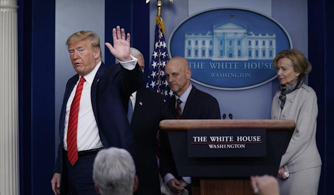 Trump leaving at the end of the coronavirus briefing at the White House on Thursday. Photo: AP
