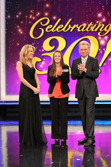 Pat Sajak and Vanna White congratulate Million Dollar Grand Prize Winner, Autumn Erhard during the show's close.
