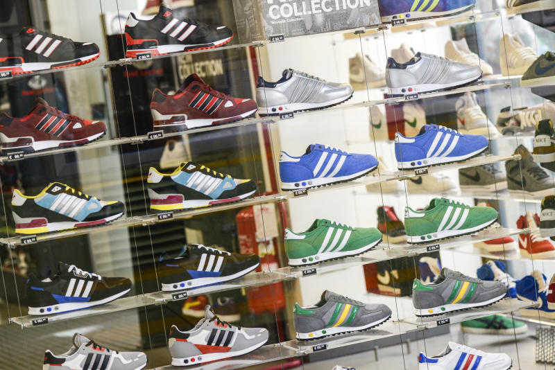 """Several Adidas shoes in Foot Locker store window in Milan city centre."""""""