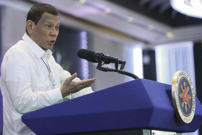 In this Monday, Feb. 10, 2020, photo provided by the Malacanang Presidential Photographers Division, Philippine President Rodrigo Duterte delivers a speech during the 11th Biennial National Convention and 22nd founding anniversary of the Chinese Filipino Business Club, Inc. in Manila, Philippines. The Philippines on Tuesday notified the United States of its intent to terminate a major security pact allowing American forces to train in the country in the most serious threat to the countriesÅf treaty alliance under President Rodrigo Duterte. (Toto Lozano/Malacanang Presidential Photographers Division via AP)