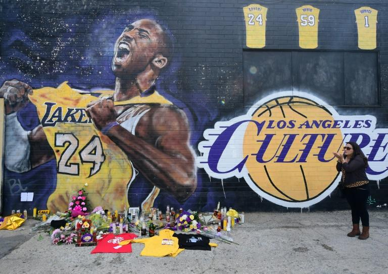 French national and longtime US resident Natalie Burle blows a kiss in direction of Kobe Bryant mural in downtown Los Angeles