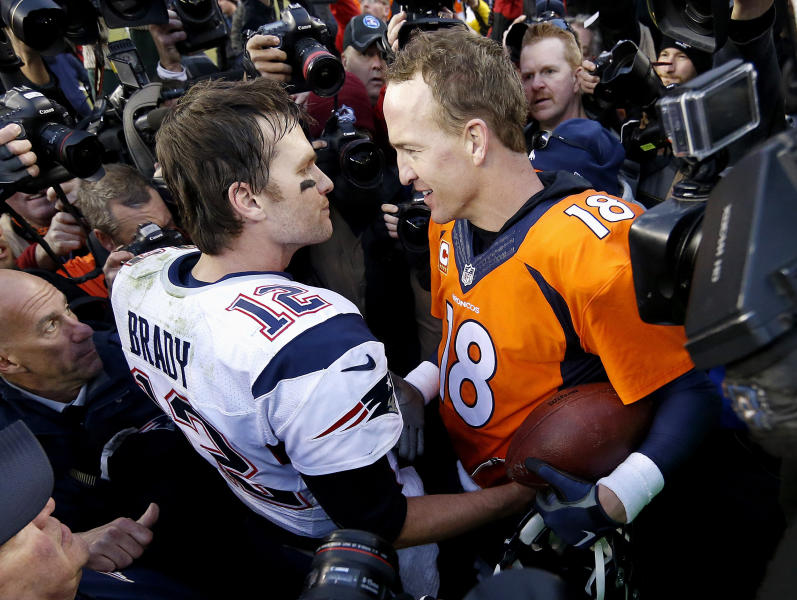 """FILE - In this Jan. 24, 2016, file photo, New England Patriots quarterback Tom Brady, left, and Denver Broncos quarterback Peyton Manning speak to one another following the NFL football AFC championship game in Denver.  The next match involving Tiger Woods and Phil Mickelson involves a $10 million donation for COVID-19 relief efforts, along with plenty of bragging rights in a star-powered foursome May 24 at Medalist Golf Club. Turner Sports announced more details Thursday, May 7, 2020, for """"The Match: Champions for Charity,"""" a televised match between Woods and Peyton Manning against Mickelson and Tom Brady. (AP Photo/David Zalubowski, File)"""