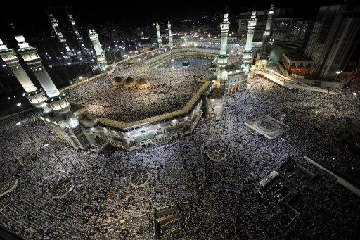Tens of thousands of Muslim piligrims perform the evening prayer in the holy city's Grand Mosque on November 2. Hundreds of thousands of Muslim pilgrims stoned Satan after massing in a valley near the Saudi holy city of Mina, the last and most dangerous rite of the annual hajj