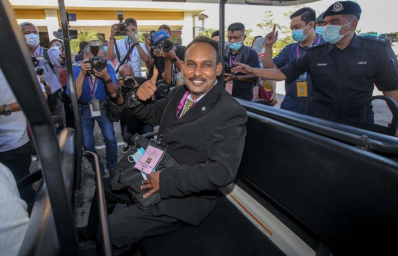 Independent candidate Santharasekaran Subramanian arrives at the nomination centre in Tanjung Malim August 15, 2020.