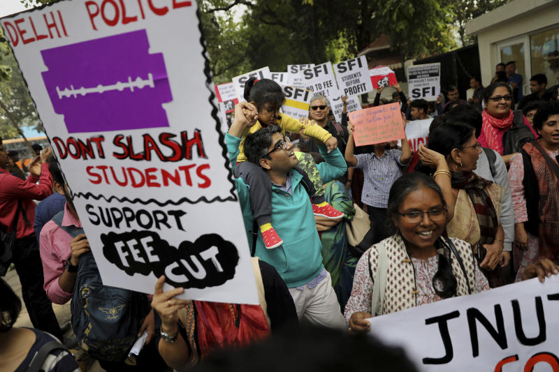 Members Jawaharlal Nehru University Teachers' Association march in support of Indian students during a protest march towards the Parliament in New Delhi, India, Saturday, Nov. 23, 2019. Hundreds of students of the Jawahar Lal Nehru University were joined by students from other universities, activists and members of civil society as they marched towards India's parliament to protest against the hostel fee hike, along with their other demands. (AP Photo/Altaf Qadri)