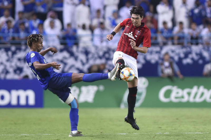 Urawa Reds' Sakine Takahiro, right, fights for the ball with Al Hilal's Andre Diaz during the first leg of the AFC Champions League final soccer match between Al Hilal and Urawa Red at King Fahd stadium in Riyadh, Saudi Arabia, Saturday, Nov. 9, 2019. Al Hilal won 1-0. (AP Photo)